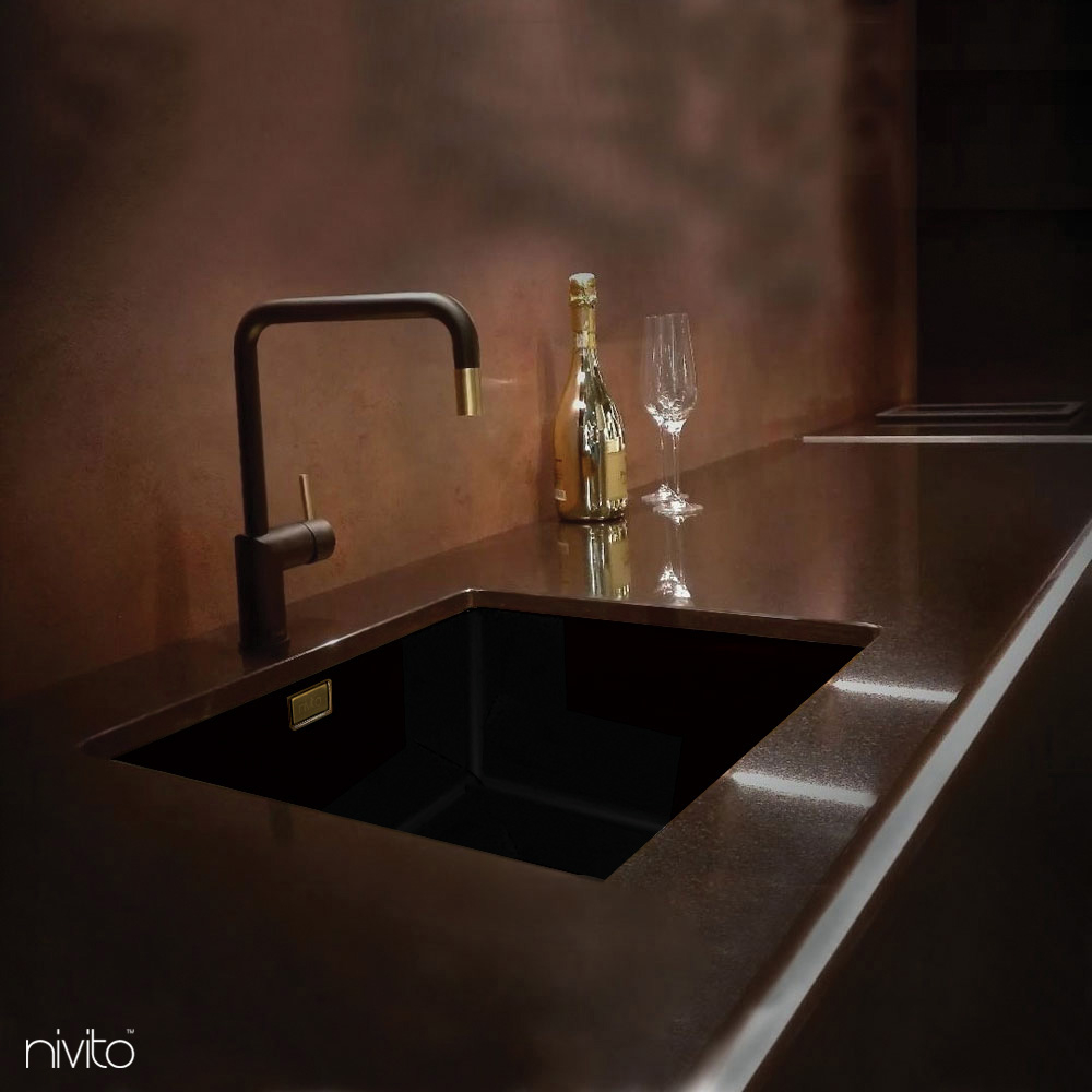 Black and gold brass tapware